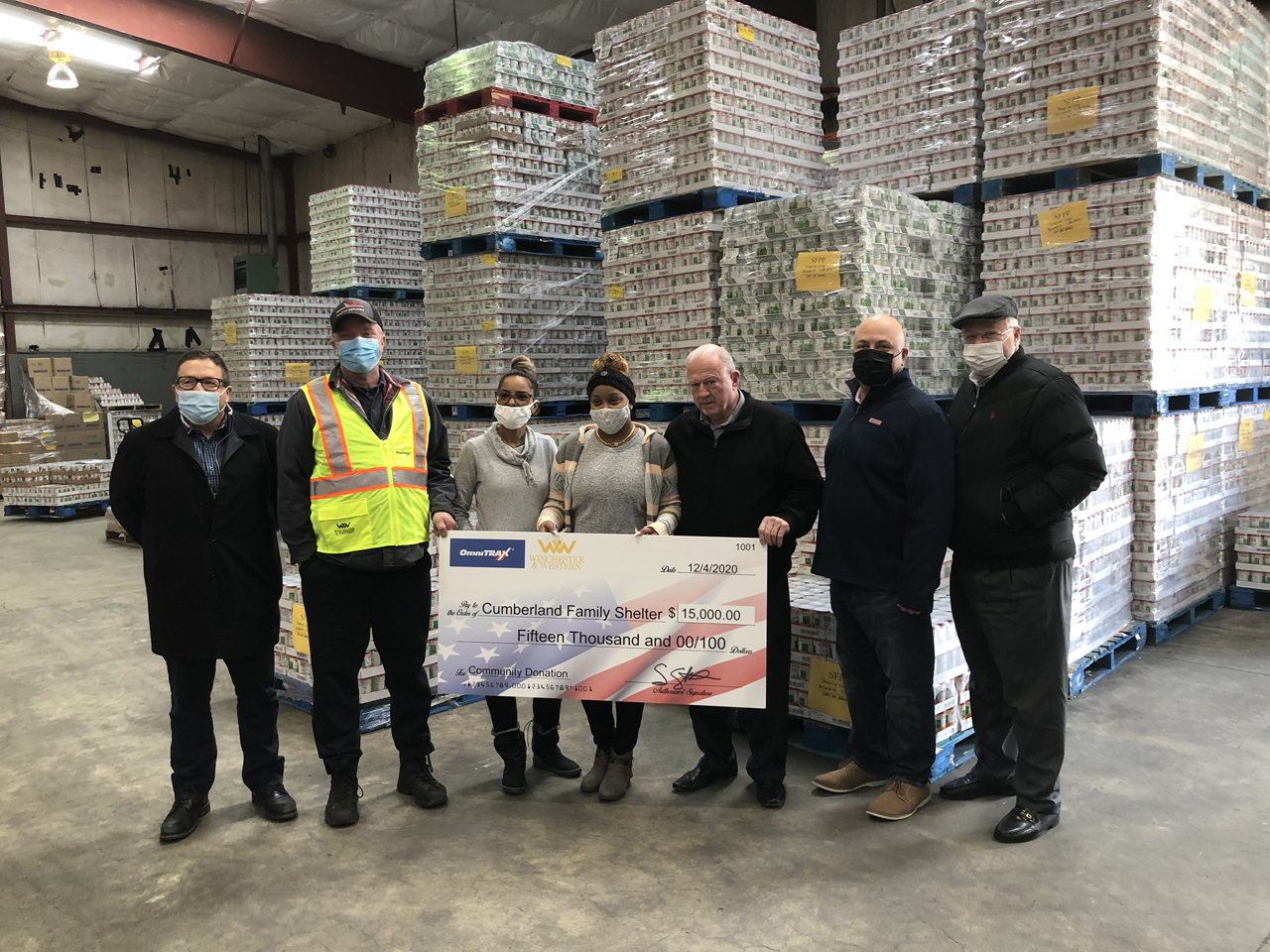 OmniTRAX COO Gord Anutooshkin (far left) recently announced partnerships with four of the company's short line affiliates to pledge meals and volunteer service for non-profits like New Jersey's Southern Regional Food Distribution Center (pictured).