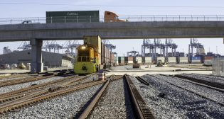 Late last month, the first CSX train ran along newly installed track connecting Garden City Terminal's Chatham and Mason Mega rail yards, as part of Georgia Ports Authority's Mason Mega Rail Terminal project. (GPA / Emily Goldman)