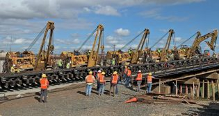 UP's 2020 capital program totaled $2.8 billion. One of the railroad's projects was the Dec. 29 installation of a new master retarder in Houston's Englewood Yard; work took close to eight hours (pictured).