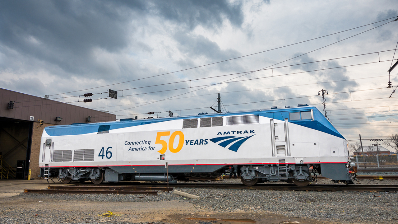 """The P42 (#46, pictured above in Ivy City) is in """"Phase V 50th"""" livery, Amtrak's standard for the past 20 years, but with the """"Connecting America for 50 Years"""" slogan and large golden yellow 50 decals. (Matt Donnelly, Amtrak)"""