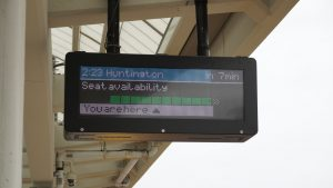 Digital platform signs now show a diagram of the arriving train, real-time seating capacity in each car, and the observer's relative position to the train (pictured) to help with seat selection.