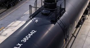 """""""When looking at the potential for new railcar demand, we expect industry deliveries to be below replacement levels this year, but believe that current inquiries support improving railcar deliveries at or just above replacement levels in 2022,"""" Trinity Industries President and CEO Jean Savage said."""