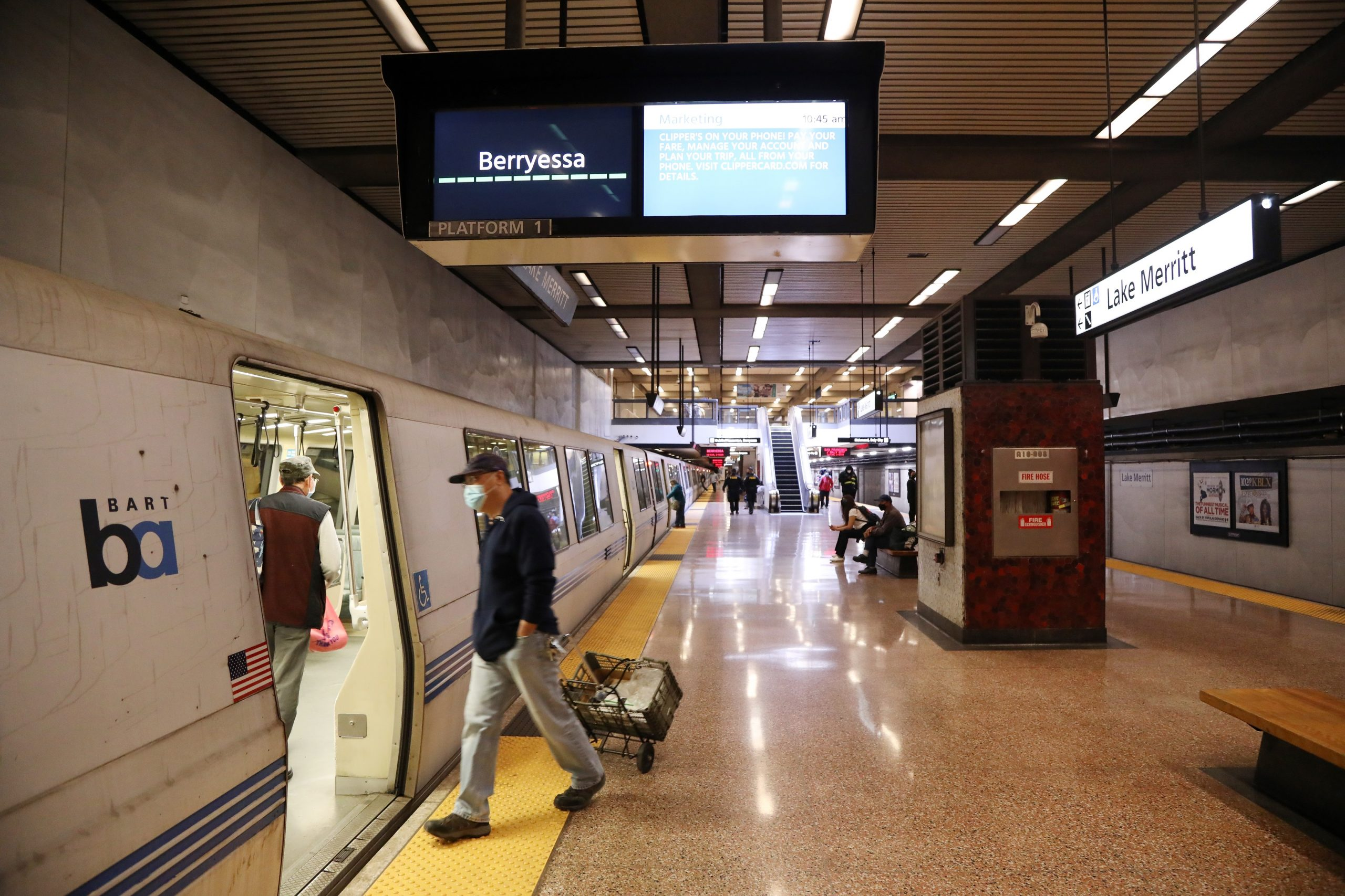 """BART Maintenance and Engineering staffers retrofitted existing LED displays at Lake Merritt Station with full-color monitors to """"demonstrate that this is an efficient, cost-effective method to get more information to customers,"""" according to the agency."""