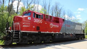 "The battery-electric locomotive (pictured) wrapped up service at the end of March, after running in a ""battery-electric hybrid consist"" between two Wabtec Tier 4 diesel-electric units across more than 13,320 miles of ""hilly terrain"" in San Joaquin Valley, Calif."