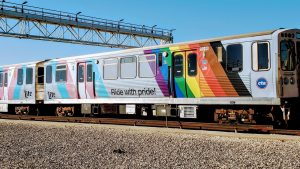 """CTA's Pride Train wrap, sponsored by Miller Lite, now features the """"Philly Flag,"""" which adds a black and brown stripe to the traditional six-color Pride Flag, as well as the blue, pink and white """"Transgender Flag."""""""