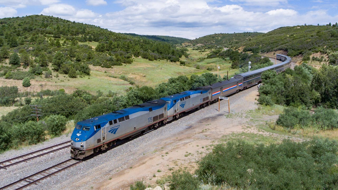 Amtrak's traditional dining service will be available beginning June 23 to riders with private rooms on western long-distance trains like the Southwest Chief (pictured near Keota, N.M.). (Photo Credit: Amtrak/Marc Glucksman)
