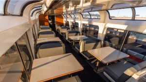 As part of a $28 million railcar modernization program, Amtrak is refreshing its Superliner fleet with new seating cushions and upholstery, tables, curtains, and more. (Pictured: Superliner Lounge)