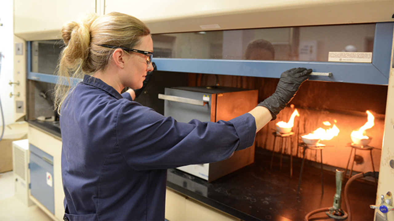 Senior Engineer I Rachel Flott analyzes diesel fuel to determine the ash content. The fuel is ignited to allow it to burn until only ash and carbon remain. (Photo and Caption: Courtesy of BNSF)