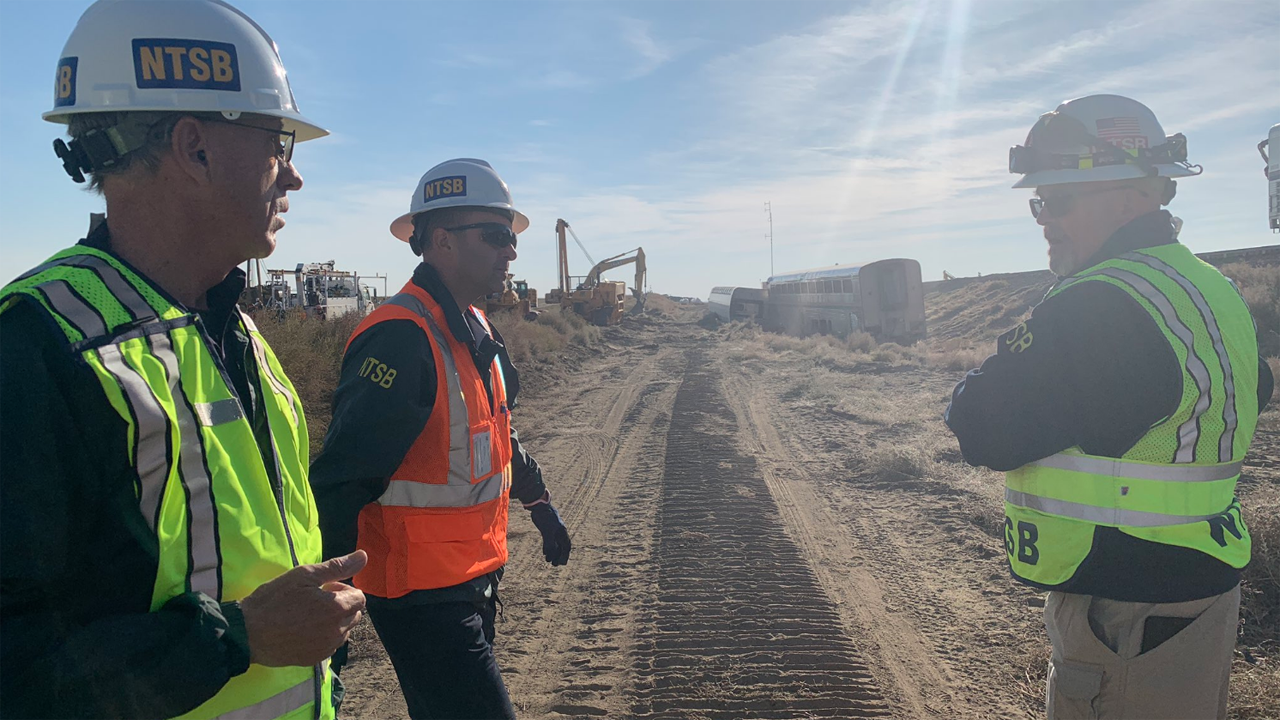 Pictured: NTSB Vice Chairman Bruce Landsberg, investigator John Manutes and Investigator-In-Charge Jim Southworth at the scene of the Amtrak derailment near Joplin, Mont. (Caption and Photograph: Courtesy of NTSB, via Twitter, Sept. 27)