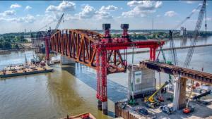Cranes perform the first segment lift of the Merchants Bridge in St. Louis.
