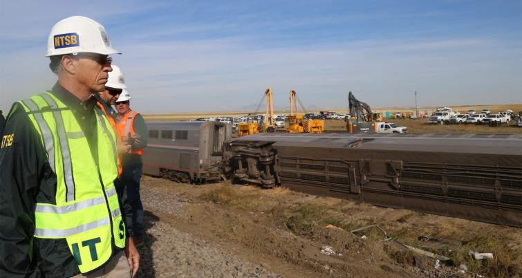Pictured: NTSB Vice Chairman Bruce Landsberg at the scene of the Amtrak derailment near Joplin, Mont. (Photograph: Courtesy of NTSB, Sept. 26)